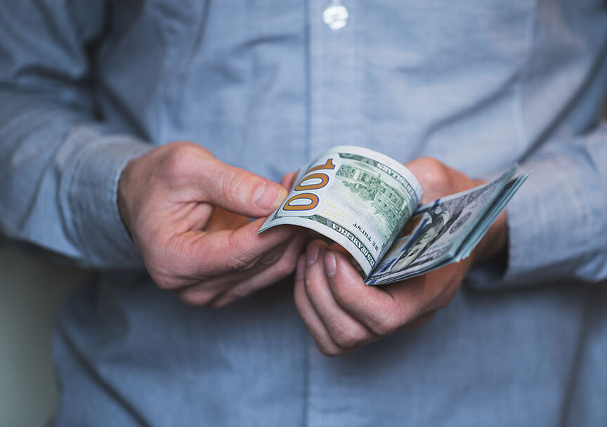 businessman-holding-money-in-his-hands